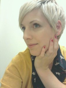red nail polish, mustard cardigan